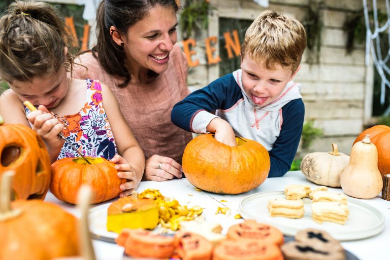 Carving pumpkins with mom